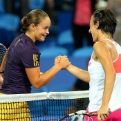 Ashleigh Barty of Australia is congratulated by Francesca Schiavone of Italy after winning her singles match during day six of the Hopman Cup at Perth Arena on January 3, 2013 in Perth, Australia; Getty Images