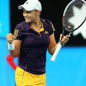 Ashleigh Barty of Australia celebrates the biggest win of her fledgling career, a 6-0 6-3 drubbing of 2010 French Open champion Francesca Schiavone of Italy at the Hopman Cup in Perth; Getty Images
