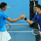 Bernard Tomic is congratulated by Novak Djokovic after upsetting the Serb 6-4 6-4 at the Hopman Cup in Perth; Getty Images