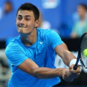 Bernard Tomic of Australia plays a backhand in his singles match against Novak Djokovic of Serbia at the Hopman Cup at Perth Arena; Getty Images