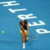 Ashleigh Barty of Australia returns a backhand to Andrea Petkovic of Germany, who ultimately retired from their women's singles match between Germany and Australia at the Hopman Cup at Perth Arena; Getty Images