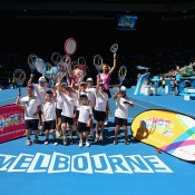 Alicia Molik of Australia poses with kids as part of  Hot Shots tennis on day two of the 2013 Australian Open at Melbourne Park on January 15, 2013 in Melbourne, Australia; Getty Images