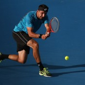 Marinko Matosevic of Australia plays a backhand in his match against Kei Nishikori of Japan during day two of the Brisbane International at Pat Rafter Arena on December 31, 2012 in Brisbane, Australia; Getty Images