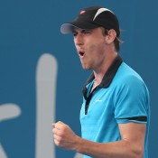 John Millman celebrates a point during his first round win against Tatsuma Ito of Japan at the Brisbane International; Getty Images
