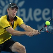 John Millman plays a backhand during his match against Andy Murray of Great Britain at the Brisbane International; Getty Images