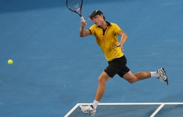 BRISBANE, AUSTRALIA - JANUARY 03:  John Millman of Australia plays a forehand during his match against Andy Murray of Great Britain on during day five of the Brisbane International at Pat Rafter Arena on January 3, 2013 in Brisbane, Australia.  (Photo by Chris Hyde/Getty Images)
