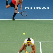 Doubles champs Bethanie Mattek-Sands (top) and Sania Mirza in action in the final against Nadia Petrova and Katerina Srebotnik at the WTA Dubai Duty Free Tennis Championships; Getty Images