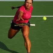 Yulia Putintseva of Kazakhstan throws her racket in an attempt to return the ball against Agnieszka Radwanska of Poland at the WTA Dubai Duty Free Tennis Championships Getty Images