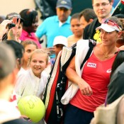 Sam Stosur meets fans after she walks off court following her win over Su-Wei Hsieh of Taipei in the opening round of the WTA Dubai Duty Free Tennis Championships; Getty Images