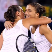 Sara Errani of Italy (R) is congratulated by compatriot and doubles partner Roberta Vinci at the end of their semifinal match - which Errani won in straight sets - at the WTA Dubai Duty Free Tennis Championships; Getty Images