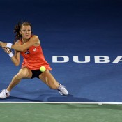 Agnieszka Radwanska plays her trademark crouch backhand in her quarterfinal loss against Petra Kvitova at the WTA Dubai Duty Free Tennis Championships; Getty Images