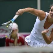 Jarmila Gajdosova serves during her opening singles rubber against Petra Kvitova in the Australia v Czech Republic Fed Cup tie; Martin Sidorjak, Tennis Arena