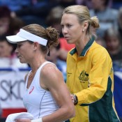 Sam Stosur (L) and Australian captain Alicia Molik during Day 1 action at the Czech Republic v Australia Fed Cup tie in Ostrava; Martin Sidorjak, Tennis Arena
