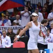 Sam Stosur reaches for the towel; Martin Sidorjak, Tennis Arena
