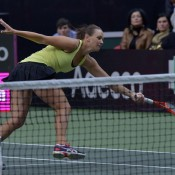 Casey Dellacqua stretches for a volley; Martin Sidorjak, Tennis Arena