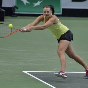 Casey Dellacqua stretches for a backhand; Martin Sidorjak, Tennis Arena