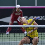 Ashleigh Barty dodges a shot during the Fed Cup doubles rubber; Martin Sidorjak, Tennis Arena