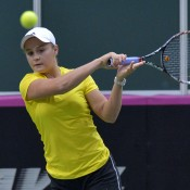 Ashleigh Barty plays a forehand during the Fed Cup doubles rubber; Martin Sidorjak, Tennis Arena