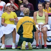 Fed Cup captain Alicia Molik chats with her charges Ashleigh Barty (L) and Casey Dellacqua (R) during the Australia v Czech Republic Fed Cup tie doubles rubber; Martin Sidorjak, Tennis Arena