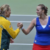 Petra Kvitova (R) shakes hands with Australian Fed Cup captain Alicia Molik after defeating Sam Stosur 2-6 7-6(3) 6-4, giving the Czech Republic an unassailable 3-0 lead in their Fed Cup World Group tie; Martin Sidorjak, Tennis Arena