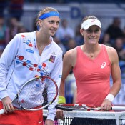 Sam Stosur (R) poses with Petra Kvitova prior to their three-set Fed Cup battle in Ostrava; Martin Sidorjak, Tennis Arena