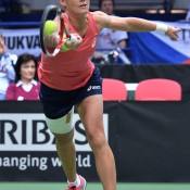 Sam Stosur plays a forehand during her three-set reverse singles Fed Cup rubber loss to Petra Kvitova of the Czech Republic; Martin Sidorjak, Tennis Arena