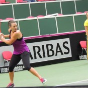 Casey Dellacqua practises with the Australian team in Ostrava, Czech Republic under the supervision of Fed Cup captain Alicia Molik; Tennis Australia
