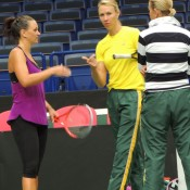 Casey Dellacqua (L) chats with Fed Cup captain Alicia Molik (centre) and coach Nicole Bradtke during an Australian team practice session in Ostrava; Tennis Australia