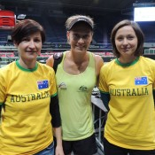 Sam Stosur (centre) poses with Bata (L) and Marta, two of her fans from Poland, a short trip from Ostrava. They watched Stosur practice and will come on the weekend to support the Australian team; Tennis Australia