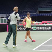 Sam Stosur (R) during a practice session in Ostrava with Australian Fed Cup captain Alicia Molik; Tennis Australia