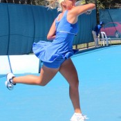 Sacha Jones plays a backhand in her match against Azra Hadzic at the Launceston Women's Pro Tour event; Denis Tucker