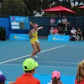 Storm Sanders nears the finish line in the final of the Launceston Women's Pro Tour event; Denis Tucker
