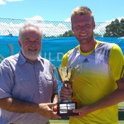 Mildura Grand International champion Sam Groth (R) is presented with the winner's trophy by Mildura Mayor Glenn Milne; Tennis Australia