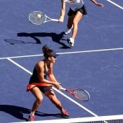 Kimiko Date-Krumm plays a volley past partner Casey Dellacqua in the pair's semifinal against Russians Ekaterina Makarova and Elena Vesnina at the BNP Paribas Open in Indian Wells, California; Getty Images