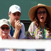 Actress Tia Carrere (R) reacts during the men's semifinal match between Tomas Berdych and Rafael Nadal at the BNP Paribas Open; Getty Images