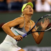 Maria Sharapova tracks a lob played by Maria Kirilenko in their semifinal match at the BNP Paribas Open in Indian Wells, California. Sharapova won in straight sets; Getty Images