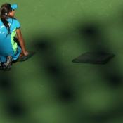 A ball kid tends her position during Day 8 of the BNP Paribas Open at Indian Wells, California; Getty Images