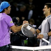 Tommy Haas (L) shakes hands with Novak Djokovic after recording a stunning upset victory over the world No.1 and two-time defending champion at the Sony Open in Key Biscayne, Florida; Getty Images
