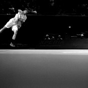 In this converted black-and-white image, Tommy Haas serves to Gilles Simon during his straight-set quarterfinal victory at the Sony Open in Key Biscayne, Florida; Getty Images