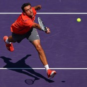 Marin Cilic stretches for a volley during his quarterfinal against Andy Murray - yet it wasn't enough to stop the Scot recording a straight-set win to advance to the last four at the Sony Open in Miami; Getty Images