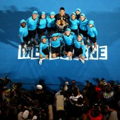 Novak Djokovic poses with ballkids after his victory at Australian Open 2013. GETTY IMAGES