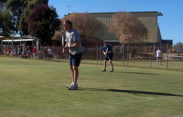 John Christiansen and Cameron Christansen, step father and step son, in doubles action at the Echuca Lawn Tennis Club annual Easter tournament; Robyn Christiansen
