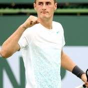 Bernard Tomic celebrates breaking Thomaz Bellucci of Brazil in the second set during his first round win at the BNP Paribas Open in Indian Wells, California; Getty Images