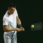 Bernard Tomic plays a backhand during his 7-6(1) 6-2 loss to Richard Gasquet in the second round of the BNP Paribas Open at Indian Wells; Getty Images