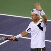 Lleyton Hewitt waves to the crowd after defeating Lukas Rosol 6-4 3-6 6-1 in the first round of the BNP Paribas Open at Indian Wells Tennis Garden in Indian Wells, California; Getty Images