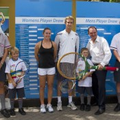 Sally Peers (third from left), Michael Look (centre) and Ipswich Mayor Paul Pisasale with school students and MLC Tennis Hot Shots participants at the City of Ipswich Tennis International draw ceremony; Tennis Australia