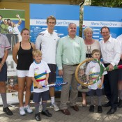 Sally Peers (second from left), Michael Look (fourth from left) and Ipswich Mayor Paul Pisasale (second from right) with representatives from Metro Hotel, school students and MLC Tennis Hot Shots participants at the City of Ipswich Tennis International draw ceremony; Tennis Australia