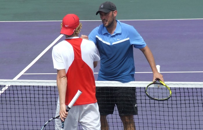 Colin Ebelthite (R) shakes hands with Jonathon Cooper after winning the men's singles title at the City of Ipswich Tennis International; Tennis Australia