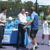 Colin Ebelthite (in blue) is congratulated during the trophy presentation after winning the City of Ipswich Tennis International; Tennis Australia