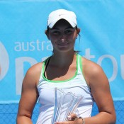 Viktorija Rajicic poses with her trophy after winning the Nature's Way Sydney Tennis International #2 Pro Tour event; Tennis Australia